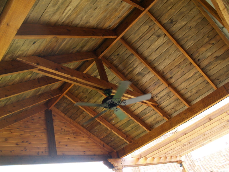 Cedar patio cover with outdoor kitchen patio - Kerrville Construction